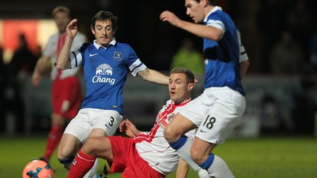 Simon Heslop in action for Stevenage with Gareth Barry and Leighton Baines of Everton