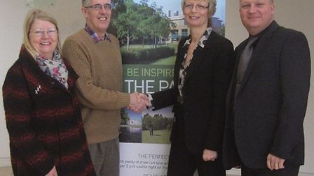 Katherine Maguire, park manager, and catering general manager Jaison Waldock (both on right) hand ov