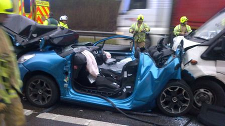 The crushed car after firefighters and paramedics used cutting equipment to free a woman trapped ins