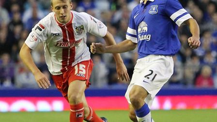 Leon Osman holds off Luke Freeman in the Capital One Cup tie between Everton and Boro. Photo: Danny