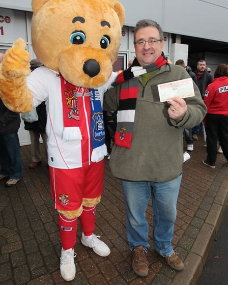 Bernie Keyte poses with his ticket and Boro bear