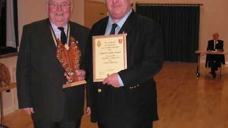 Outgoing president of Essex County RBL, Malcolm Ratcliffe, presenting chairman of the Debden RBL bra
