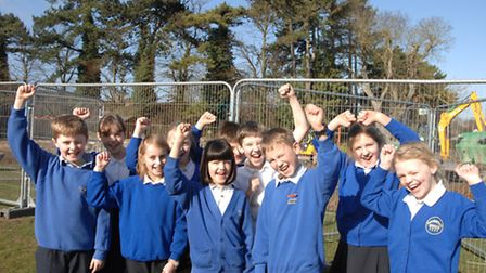 Year 5 pupils at RA Butler Academy celebrating work getting underway on their new all-weather sports