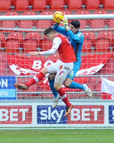 Alex Revell challenges Chris Day in the build up to Rotherham's opening goal. Picture: Allan Millard