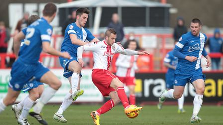 Dean Parrett competes for the ball. Photo: Harry Hubbard