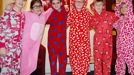 Great Dunmow Primary pupils in their onesies, from left, Isabel, Yara, Alfie H, Hannah, Alfie C and