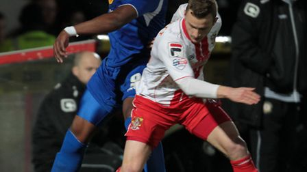 Dean Parrett competes for the ball