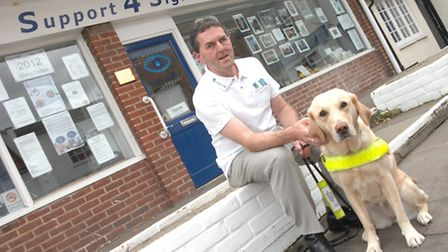 Support 4 Sight volunteer manager Paul Atkins with his assistance dog, Nessie.