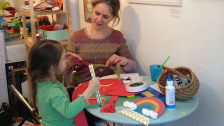 Jane Glynn working with a young girl during a Rainbow Day event at the gallery on Saturday