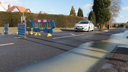 Police attending the scene of the burst water main in Norton Road in Letchworth GC