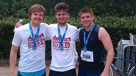 Alex Milne (centre) and his university friends Zak Green and Peter Gibson after completing the Sheff