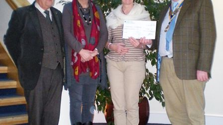Linda Robinson and Kathryn Winfield from Homestart, receiving the cheque from John Sibson and Tony C