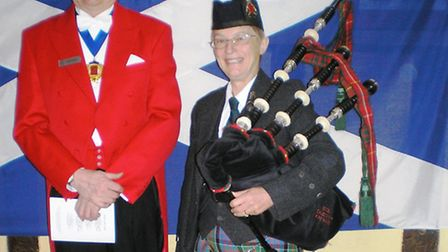 Master of Ceremonies Richard Crawte, and the piper, Lt Col Jackie Allen.