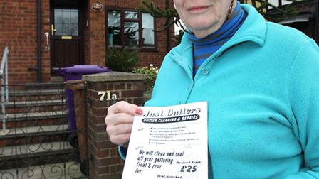 """Hilde Betts holds a flyer from """"Just Gutters"""" which was put through her door"""