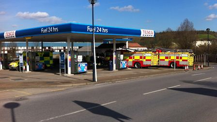 An elderly woman was taken to hospital after her car crashed into the kiosk at Tesco's petrol statio