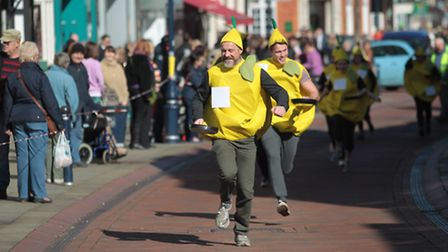 Runners take part in the pancake race in Hitchin