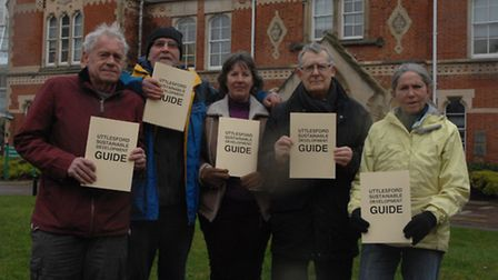 Walden in Transition members with copies of the guide.