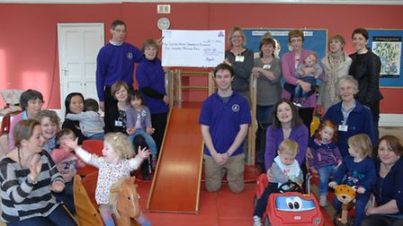 Saffron Walden Opportunity Playgroup are presented with a cheque for £200.
