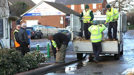 John O'Connor workers fill sandbags to protect the Plume and Feathers Pub in Little Wymondley