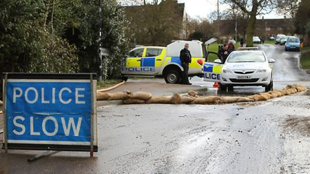 Police in Little Wymondley with sandbags on the road