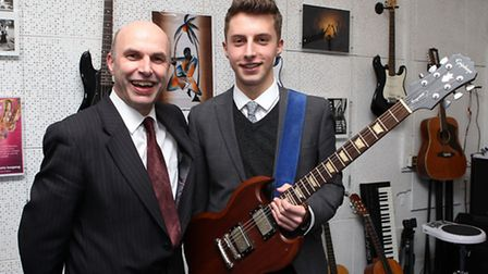 John Henry Newman Head of Music Phillip Wright with student Tom Croysdill who's song topped the iTun