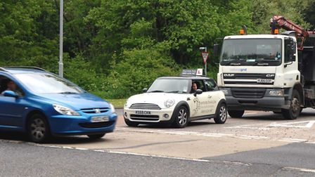 Cars queue as they try to get out of Charlton Road. Picture by Keith Dobney.