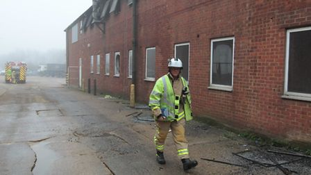 Fire at Winters House, Hunting Gate, Hitchin. Firefighter at the scene