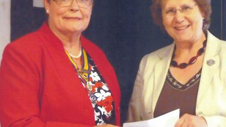 The Phoenix Group for Deaf Children - pictured receiving a cheque from the Inner Wheel Club of Steve