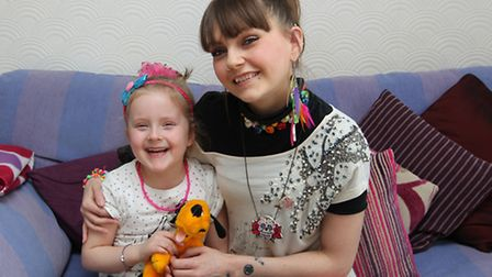 Ruth Bussey, who suffers from at least four epileptic seizures a day, with her five-year-old daughte