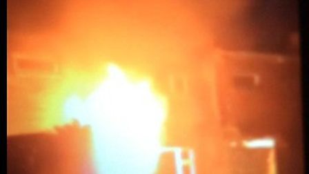 A picture taken of the fire at the ground floor of a house in Maddles, Letchworth GC in the early ho