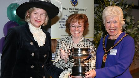 Fundraising manager Jean Robinson (centre) collecting the award on behalf of Age UK Essex from High