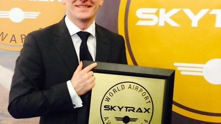 Stansted's managing director, Andrew Harrison, with the SKYTRAX award at the ceremony in Barcelona o