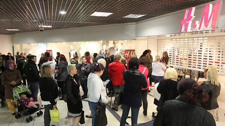 People wait for the new H&M store to open in Westgate Shopping Centre in Stevenage