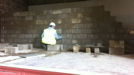 A brick wall has been built halving the stage space in Hitchin Town Hall