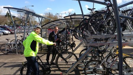 Access Walden's James Savage (front) and Paul Gadd try out the new cycle racks at Audley End station