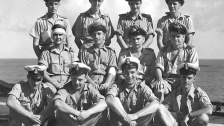 Bob Taylor on board the aircraft carrier HMS Victorious, front row second from right, during the Sec