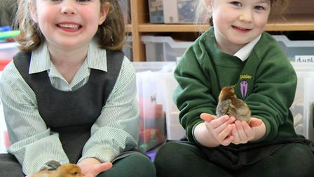 Friends' Junior School pupils Camille and Jessica with their Easter chicks.
