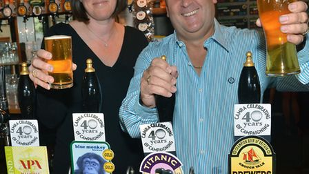Claire Sturgeon and Kevin Machin behind the bar at The Engineers Arms in Henlow