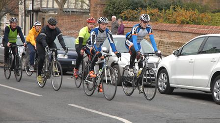 The riders coming up High Street past St Mary's Church.