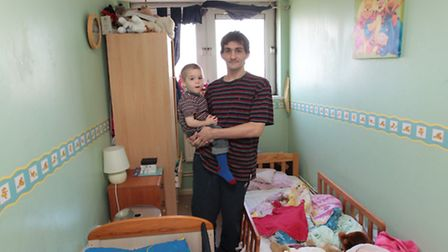 Derick and his son Kyle in their flat