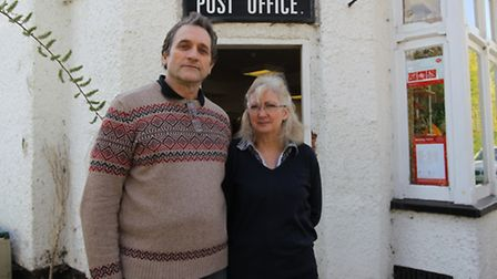 Shopkeepers Robert and Sue Middleton outside their Post Office in Willian