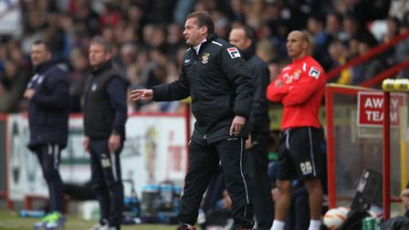 Graham Westley shouts instructions to his players. Photo: Harry Hubbard