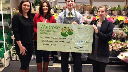 From left, Emilia Linwood and Morag Linwood, receive the cheque from Waitrose customer service staff