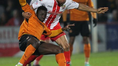 Darius Charles challenges for the ball against Wolves. Photo: Harry Hubbard