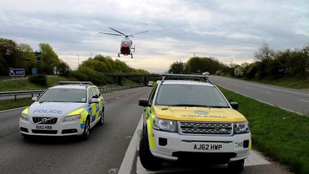 An air amulance attends the scene on the A1(M) on Saturday - Credit: @AmboOfficer