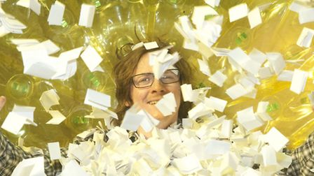 Ed Byrne delves into the Spring Raffle tickets inside the zorb. Photos by Peter Cozzi- Frank G.Gates