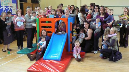 Anita Latter (centre) has been a leader of Tea and Toddlers since 1989 and attracts plenty of childr