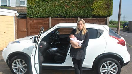 Ashley Broadbent with her newborn baby Pennie and the car she gave birth in