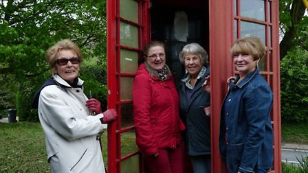 From left, Billie Rochford, Laura Clare, Liz Newton and Rhona Norden in the phone box.