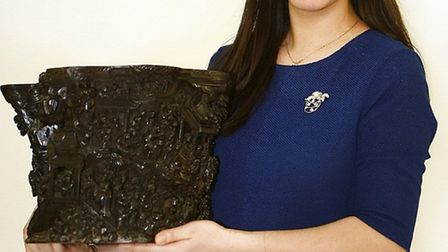 Chinese calligrapher's brush pot which sold for 150,000 being held by Sworders's Asian Art specilais